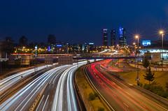 Noches de Madrid. (Amparo Hervella) Tags: madrid españa spain nocturna estela paisaje paisajeurbano 4torres largaexposición d7000 nikon nikond7000