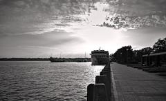 Crusin' (heric09) Tags: boat river cruise bw blackandwhite clouds sun