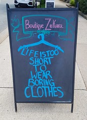 Life is too short to wear boring clothes (Coastal Elite) Tags: life too short wear boring clothes halifax novascotia boutique zekara northend slogan message sidewalk board advertisement advertising blackboard chalkboard chalk