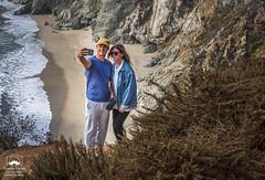 A Precarious Selfie (allentimothy1947) Tags: cahwy1 california monetereycounty beach blue camera cellphone dangerous glasses hat lookout pacifichighway pacificocean path people photographrs rocky surf selfie bixbycreekbridge