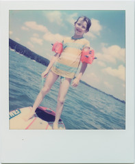 Stand up paddling (SX-70) (mmartinsson) Tags: 2018 sx70 polaroidoriginals color sup lake scan schondorf instantfilm ammersee epsonperfectionv700 polaroid summer paddling analoguephotography schondorfamammersee bayern tyskland de