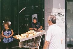 Street vendor (dtavlikos) Tags: leicacl kodak colorplus200 colorplus cp200 c072492r1000a streetphotography vendor urban citylife thessaloniki macedonia makedonia greece hellas θεσσαλονίκη μακεδονία ελλάδα