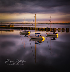 Langstone Harbour, Hampshire, U.K. (Andrew J Hulson) Tags: boats chichesterharbour langstoneharbour leefilters water sea seascapes portsmouth haylingisland havant harbour hayling channel england three waiting reflections yachts uk sunset englishchannel solent