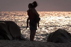 dolce tramonto (ROSSANA76 Getty Images Contributor) Tags: dolce tramonto maternità madre figlia sole rosa acqua mare sabbia rocce scogli scintillio bimba donna mamma dolcezza famiglia legami emozione sentimenti amore materno affetto