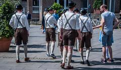 2018 - Germany - Düsseldorf - Lederhosen (Ted's photos - For Me & You) Tags: 2018 cropped düsseldorf germany nikon nikond750 nikonfx tedmcgrath tedsphotos vignetting males suspenders shots streetscene street people peopleandpaths pathsandpeople leggings stockings hats lederhosen shadows shadow nike sneakers shoes footwear