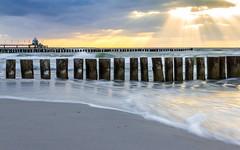 Striking light ([-ChristiaN-]) Tags: langzeitbelichtung strand beach le long exposure water waves wasser wellen sunset night pier seebrücke zingst sky light blue hour meer himmel ozean sonnenuntergang