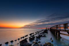Waiting for Sunrise (Johan Konz) Tags: sunrise water sea rock stone waterscape seascape jetty pier edam markermeer netherlands outdoor le longexposure nikon d7500 orange blue cloud sky depth coast shore bay fishingpole
