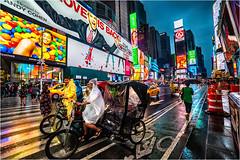 Times Square Rickshaw (beninfreo) Tags: rokinon14mm canon colour reflection night rain pedicab rickshaw timessquare newyork