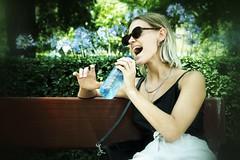 Singin' in the park (Alizarin Krimson) Tags: happy mood madrid retiro parquedeelretiro portrait bench waterbottle bottle woman girl park singing