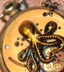 Clutching Cogwheels (dianne_stankiewicz) Tags: macro octopus jewelry steampunk brass bronze watch macromondays hmm cogwheel chain cogwheels clutching gold golden bokeh pocketwatch vintage