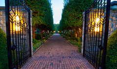 The Garden Gates (KC Mike Day) Tags: gates garden kauffman city ewing marion flowers brick path lights evening