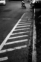 The trick driver (Nikon F80) (stefankamert) Tags: stefankamert street trick driver people lines highcontrast analog film grain mood nikon f80 slr voigtländer ultron noir blackandwhite blackwhite bw baw kodak trix