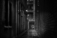 dark alley (heinzkren) Tags: schwarzweis blackandwhite bw sw monochrome panasonic lumix urban candid urbanart city stadt london moltonstreet street streetphotography dark bricks ziegel building gebäude mood magical mystery woman people person architecture wall mauer uk