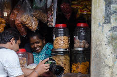 The Delight of Digital Photography (*shutterbug_iyer*) Tags: digital immediate shywoman coy retailer shopkeeper review chimping smile camera photographer snacks