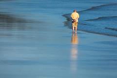 Yellow Man, Long Beach (josullivan.59) Tags: 2018 bc britishcolumbia canada island pacific tamron150600 tofino vancouverisland beach blue clear day detail evening goldenhour minimalism ocean outdoor outside reflection sea seashore telephoto texture wallpaper water waves yellow