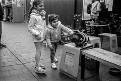 meeting the blind rescue cats  #418 (lynnb's snaps) Tags: 201808 35mm cv21mmf4ltm ilfordfp4 leicaiiic manly xtol bw blackandwhite cafe cats children film fp4 street manlyvillage sydney australia 2018 cute bianconegro blackwhite bianconero biancoenero blancoynegro noiretblanc monochrome ishootfilm leicafilmphotography cv35mmf25colorskoparltm rangefinderphotography barnack ©copyrightlynnburdekinallrightsreserved