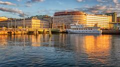 Göteborg (anderswetterstam) Tags: city evening harbor light sky sunset sunshine summer reflection water sea colorful ship boat