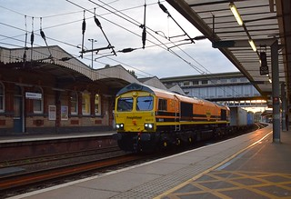 Genesee and Wyoming liveried Freightliner 66413 hauls the 18.12 Felixstowe North - Lawley Street Intermodal through Ipswich after a 60 minute layover in the Yard. 17 08 2018
