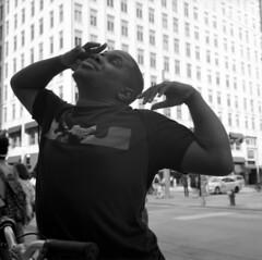 untitled (kaumpphoto) Tags: rolleiflex 120 tlr bw black white street urban city boy minneapolis building windows bike handles stretch hands