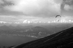 Silence (Roberto Spagnoli) Tags: silence silenzio garda mountain montebaldo alone clouds biancoenero blackandwhite monocromo panorama paesaggio landscape paragliding parapendio lagodigarda lake fujix100t