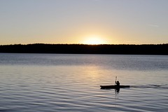 The sun comes down, the kayak goes (daveynin) Tags: lake caldera newberry nps oregon sunset dawn kayak canoe padding silhouette