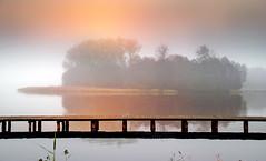 Island (augustynbatko) Tags: island lake landscape nature fog sky sun bridge pier tree water mist forest sunset wood