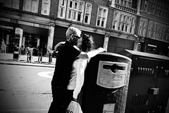 IMG_6477 (1) (JetBlakInk) Tags: mono couple lovers streetphotography pov candidportrait kissing manandwoman