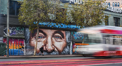 robin williams tribute by andres iglesias (pbo31) Tags: bayarea california nikon d810 color september 2018 summer boury pbo31 sanfrancisco city urban lightstream motion traffic art mural giant robin williams marketstreet tenderloin muni streetcar blur roadway eyes