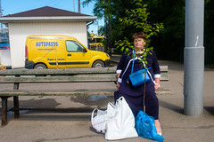 Riga, Latvia (f.d. walker) Tags: baltics easterneurope europe latvia riga woman plant tree bush color candidphotography candid colorphotography city clothes colors streetphotography street sunlight surreal strange funny face