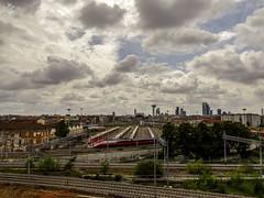 Cieli di fine estate. Milano (diegoavanzi) Tags: cielo sky clouds nuvole milano milan italia italy lombardia lombardy sony hx300 bridge grattacieli skyscrapers skyline stazione station ferrovia railway