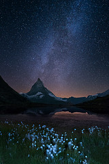 Lake Riffelsee - Milky way over Matterhorn - Switzerland (Palnick) Tags: peak scenery night water zermatt alps lake reflection switzerland riffelsee mountain landscape matterhorn rock interest rocky summit ridge holiday mountaineering famous environment stars wallis attraction hiking valais pyramid travel scape sky majestic swiss climbing landmark high view gornergrat mount sightseeing morning ice trekking wilderness mirror panorama mountaineer light coldlight cold milky way