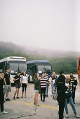 (romy_clair) Tags: mountains fog nature bus tourists group people busan south korea asia travel colour color east analogue amateur film 35mm portrait
