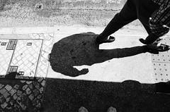 Passing by (ewitsoe) Tags: film analog fm2 nikon lison shadow people city urban monochrome blackandwhite series fujifilm camera filmisnotdead street bnw balckandwhite portugal lisboa ewitsoe shadows sunny contrast grain