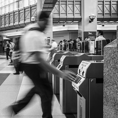 Running Late (John St John Photography) Tags: streetphotography candidphotography secaucusjunction njtransit ticket reader man commuter rushing scanners bw blackandwhite blackwhite blackwhitephotos johnstjohnphotography