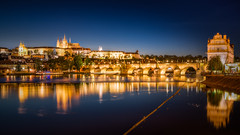 Prague Castle and Charles Bridge (hpd-fotografy) Tags: charlesbridge czech moldau prague river architecture bluehour boat bridge castle cathedral city cityscape longexposure medieval night panorama reflection skyline
