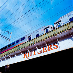 Rutgers Sign (Dalliance with Light (Andy Farmer)) Tags: mediumformat bridge lomographyf2400film 6x6 nj 120film newbrunswick rutgers hasselblad500cm train film njtransit newjersey unitedstates us