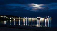 Scapa Pier at Night from Scapa Bay, Orkney (Peter Starling) Tags: 2018 orkney peterstarling scotland starling island islands isle isles summer mainland sea bay ship harbour lights reflection moon cloud long exposure blue sky motion blur dark nighttime shore canon 7dii 7dmk2 7dmkii 7d2 24105 l kirkwall