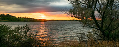 Sunset over Sweet Briar Lake, North Dakota (mesocyclone70) Tags: sunset lake water reflection clouds silhouette colors trees