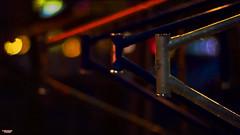Rack 'Em Up (MBates Foto) Tags: artistic availablelight bikerack bokeh carlzeiss closeup color evening existinglight frame night nikon nikond810 nikonfx nocturnal outdoors textures vividcolor zeisslens urban