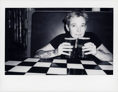 TIP Beer Anne (tobysx70) Tags: fujifilm fuji instax wide monochrome bw black while instant film bigpitchers 500af camera tip beer anne smokin' moe's ribhouse saloon cooper creek way mall winter park colorado co portrait woman female new belgium brewing voodoo ranger ipa check tattoo booth shorthairdontcare polaradoone polarado 071918 toby hancock photography