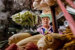 Corn vendor (Goran Bangkok) Tags: bangkok thailand vendor corn food man hat urban