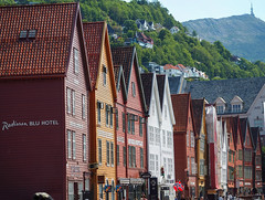 Bergen Bryggen Waterfront (joiseyshowaa) Tags: tyskebryggen water front norway nordic atlantic ocean harbor history historic museum re creation wooden frame fire pier vagen unesco world heritage hanseatic league shop restaurant pub tourist travel holiday cruise ship fish market hotel hostel radisson blu 26 north nightclub 1480 gallery red roof mountain warehouse window door tower hill houses