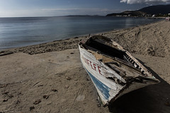 No longer worthy of the sea (Anthony P.26) Tags: boat category decay erdek kapidag places seascape transport travel turkey canon canon550d canon1585mm outdoor beach beachlife ruin sand seadshore coast coastline coastal perspective pov headland seaside water calmwater calmsea