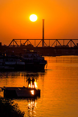 Colors of sunset (petrovicka95) Tags: sunset belgrade river danube europe sky sun orange silhouette shadow light people street summer color