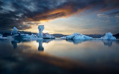 Land of Fire and Ice (BlinkOfALens) Tags: easternregion iceland is glacier iceberg lagoon sunset water ice reflection