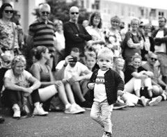 Little Boy Walking (d_t_vos) Tags: littleboy walking walk walker street streetphotography streetportrait people crowd monochrome zwartwit busy levis short dof perspective attention centre focus outside naturallight sunnyday sunny hoeksterend waiting leeuwarden cute dickvos dtvos