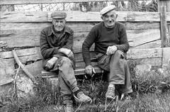 Two old gentlemen sitting on a bench (Lighthousedreams) Tags: h3dii22 hasselblad mittelformat medium format alt old men man farmer bauer mustache schnurrbart slippers hausschuhe schwarzweis schwarzweiss blacknwhite blackandwhite poverty armut