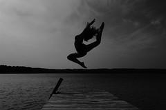 Jump (MasterKrzych) Tags: jump jumping water wood forest background sky monochrome monochromephotography black white blackandwhite silhouette gymnastic gymnastics acrobatic cloud clouds summer lake mazury poland polish polishgirl girl sport sports fit canon canonphotography polishphotography