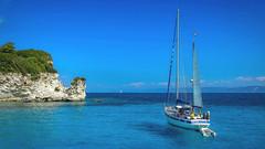 Voutoumi Beach (George Nutulescu) Tags: sea seascape season nikon travel water waves blue ship holiday greece boat oceam sky bay ocean