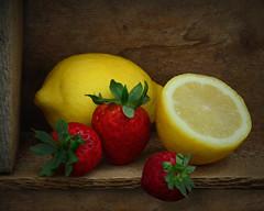 Berry Overboard! (njk1951) Tags: fruit berries strawberries freshfruit woodencrate lowlight lemonhalf sweetsour stilllife summerflavors red yellow